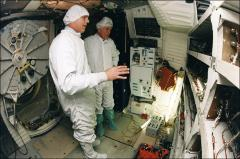Thumbnail of Stephen Oswald and John Glenn tour the Space Shuttle Discovery during Glenn's training
