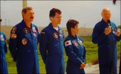 Thumbnail of John Glenn and fellow crew members of the Space Shuttle Discovery at a Kennedy Space Center press conference