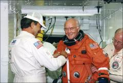 Thumbnail of John Glenn has his space suit checked prior to launch