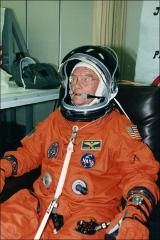 Thumbnail of John Glenn waits in his space suit prior to departure for the launch pad