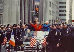 Thumbnail of John and Annie Glenn riding in the New York City parade honoring the Space Shuttle Discovery mission