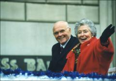 Thumbnail of John and Annie Glenn ride in a parade following NASA mission STS-95, 1998