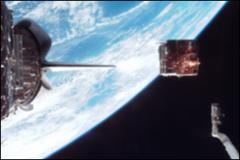 Thumbnail of Spartan satellite being released into space