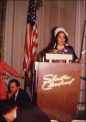 Thumbnail of Annie Glenn at a podium during an event for John Glenn's campaign for the U.S. Senate in 1964