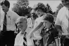 Thumbnail of John Glenn poses with children during re-election campaign in 1980