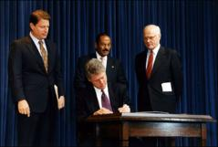 Thumbnail of John Glenn watching President William Clinton signing Glenn's National Performance Review and Procurement Reform into law