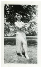Thumbnail of Annie Glenn in a hula outfit