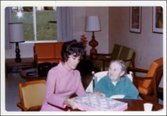 Thumbnail of Annie Glenn visiting a resident of the Norworth Convalescent Center