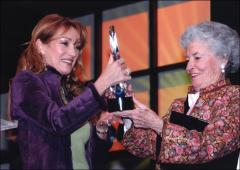 "Thumbnail of Annie Glenn presents actress Jane Seymour with the ""Annie"""