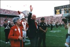 "Thumbnail of Annie and John Glenn ""dot the I"" of Script Ohio"