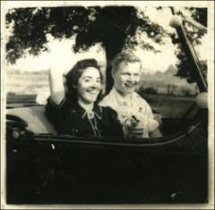 "Thumbnail of Annie Castor and John Glenn in Glenn's car ""The Cruiser,"" 1938"