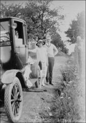 Thumbnail of Ralph and Florence Sproat Thompson beside automobile