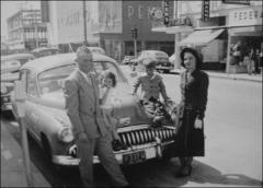 Thumbnail of John Glenn family gathered around their automobile after church services in Corpus Christi, Texas, 1949