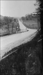 "Thumbnail of State Route 40 going west from New Concord towards the old ""S Bridge,"" October 1926"