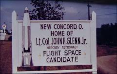 "Thumbnail of Sign on the outskirts of New Concord, Ohio, reading ""Home of Lt. Col. John H. Glenn Jr. - Mercury Astronaut - Flight Space Candidate"""