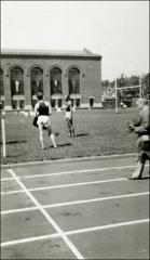 Thumbnail of Jesse Owens, center, preparing for track meet, (unclear image), 1935