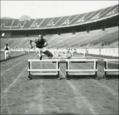 Thumbnail of Jesse Owens practicing hurdles, 1936