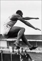 Thumbnail of Jesse Owens competing in the broad jump at the Olympics, 1936