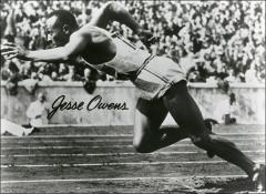 Thumbnail of Jesse Owens pictured while running at the Berlin Olympics, side view, 1936