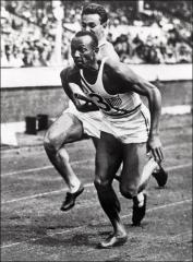 Thumbnail of Jesse Owens and teammate competing in the 400 meter relay, Berlin Olympics, 1936