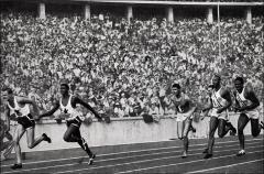 Thumbnail of Jesse Owens and fellow Olympians competing in the 400 meter relay, Berlin Olympics, 1936