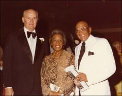 Thumbnail of Jesse and Ruth Owens posed for a portrait with an unknown man, circa 1970s
