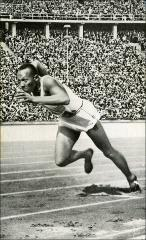 Thumbnail of Jesse Owens competing in the 200 meter dash at the Berlin Olympics, 1936