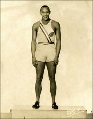 Thumbnail of Full-length portrait of Jesse Owens in his Olympic uniform, 1936
