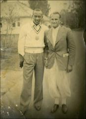 "Thumbnail of Jesse Owens and ""Bendler"" posed for a portrait, 1936"