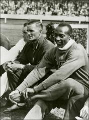 Thumbnail of Jesse Owens and fellow Olympians preparing for an event, 1936