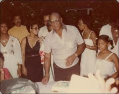 Thumbnail of Jesse Owens with family and friends at a family celebration, circa 1970s