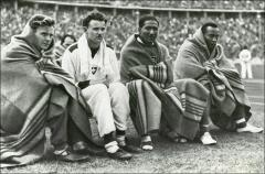 Thumbnail of Jesse Owens and fellow Olympians staying warm between events, 1936
