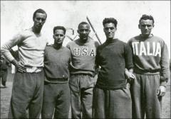 Thumbnail of Jesse Owens posed with fellow Olympians at practice, 1936