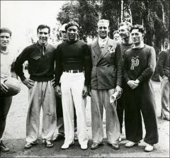 Thumbnail of Jesse Owens standing with an unidentified group, Berlin, 1936