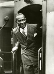 Thumbnail of Jesse Owens leaving a train car, 1936