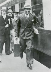 Thumbnail of Jesse Owens carrying his suitcase, 1936