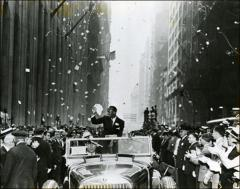 Thumbnail of Jesse Owens riding in the New York City ticker tape parade, 1936