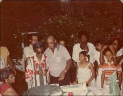 Thumbnail of Jesse and Ruth Owens with family and friends at a family celebration, circa 1970s