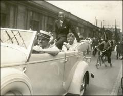 Thumbnail of Jesse Owens riding in the Columbus parade, 1936