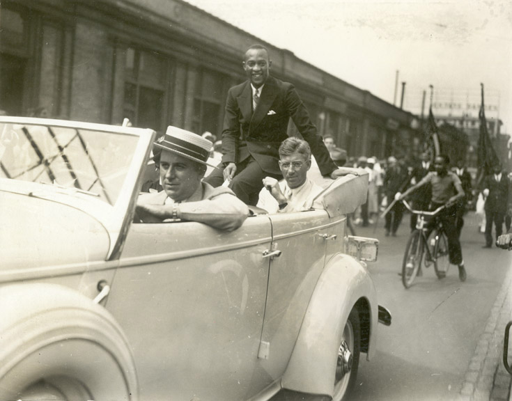 Jesse Owens riding in the Columbus parade, 1936