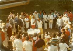 Thumbnail of Jesse and Ruth Owens in a circle of friends and family, circa 1970s