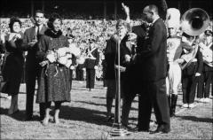 Thumbnail of Jesse Owens presenting his daughter, Marlene, with the Ohio State Homecoming Queen trophy, 1960