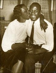 Thumbnail of Ruth Owens kissing Jesse during their trip to New York City, 1936