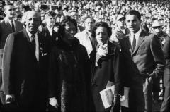 Thumbnail of Jesse, Marlene, and Ruth Owens posed with Stuart Rankin at Homecoming, 1960