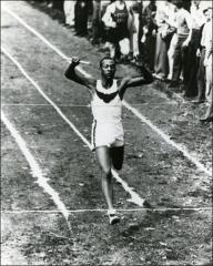 Thumbnail of Jesse Owens crossing finish line at high school meet, 1930s