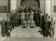 Thumbnail of Alpha Phi Alpha on building steps, circa 1934-1936