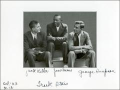 Thumbnail of Jesse Owens sitting with fellow Ohio State University track members, 1933