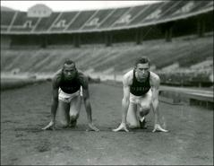 Thumbnail of Jesse Owens and Edward Gazdik posed in starting position facing the camera at Ohio Stadium, 1934