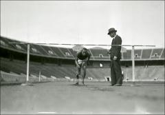 Thumbnail of Coach Larry Snyder training Jesse Owens, 1934