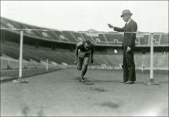 Thumbnail of Coach Larry Snyder training Jesse Owens, shown running with his head down, 1934